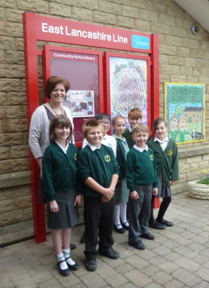 Deputy Head Janet Ennis with some of the pupils by the boards