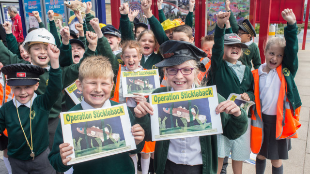 Pupils celebrate the launch of the book